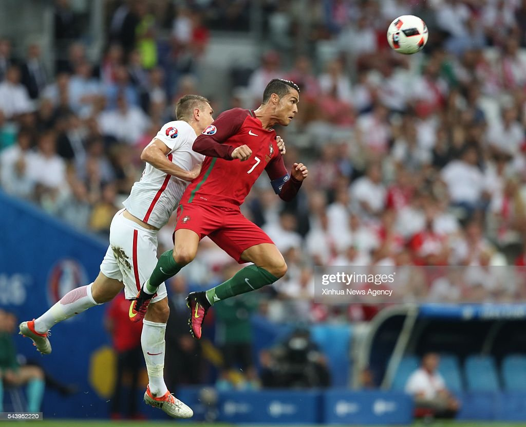 MARSEILLE, July 1, 201 -- Cristiano Ronaldo, right, of Portugal competes during the Euro 2016 quarterfinal match between Portugal and Poland in Marseille, France, June 30, 2016.