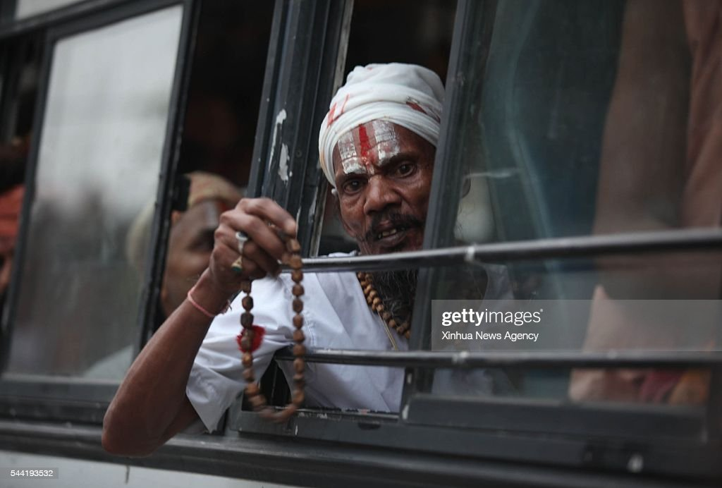 JAMMU, July 1, 2016 -- A sadhu starts his pilgrimage to the Amarnath cave in one of the first batch of buses departing from Jammu, Indian-controlled Kashmir, July 1, 2016. Thousands of Hindu devotees will join the yearly pilgrimage that starts on July 2 this year, to see an ice stalagmite formed inside the cave.