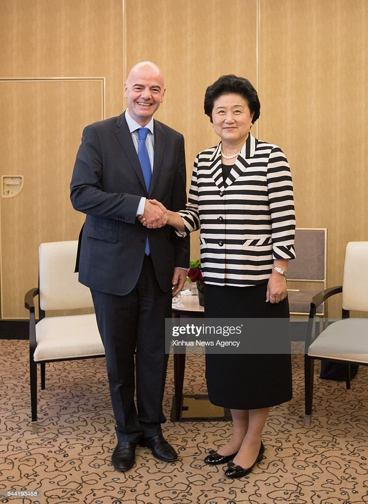 PARIS, July 1, 2016 -- Chinese Vice Premier Liu Yandong, right, meets with Gianni Infantino, president of the world's football governing body FIFA in Paris, France on July 1, 2016. Visiting Chinese Vice Premier Liu Yandong meets on Friday with Gianni Infantino, president of the world's football governing body FIFA, on China's football reform.