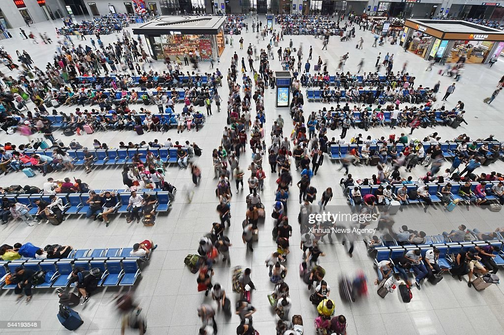 CHANGCHUN, July 1, 2016-- Passengers are seen in the waiting room of Changchun Railway Station in Changchun, northeast China's Jilin Province, July 1, 2016. A total of 560 million rail trips will be made during the upcoming two-month summer travel peak, up 55.5 million from one year earlier, the China Railway Corporation forecast on Thursday.