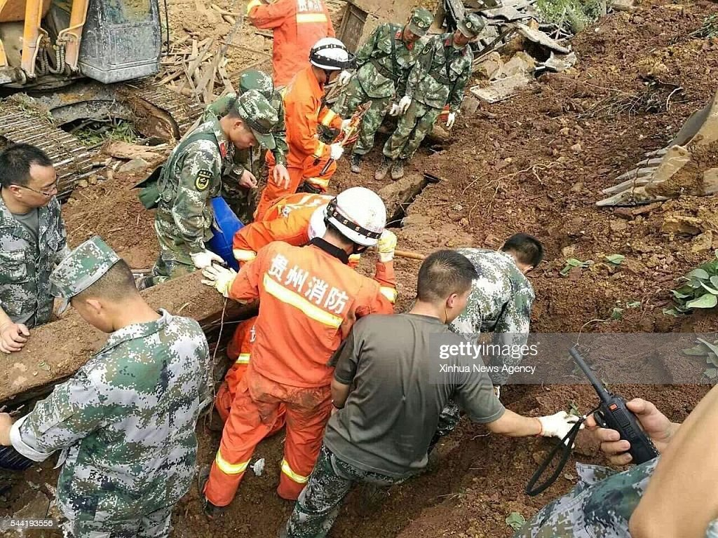 DAFANG, July 1, 2016-- Rescuers work at the accident site after a rain-triggered landslide hit Pianpo Village, Dafang County in the city of Bijie, southwest China's Guizhou Province, July 1, 2016. The landslide on Friday morning buried 29 people in the village. Nine people have been out of the rubble, but one of them was dead. The other eight have been rushed to hospital.