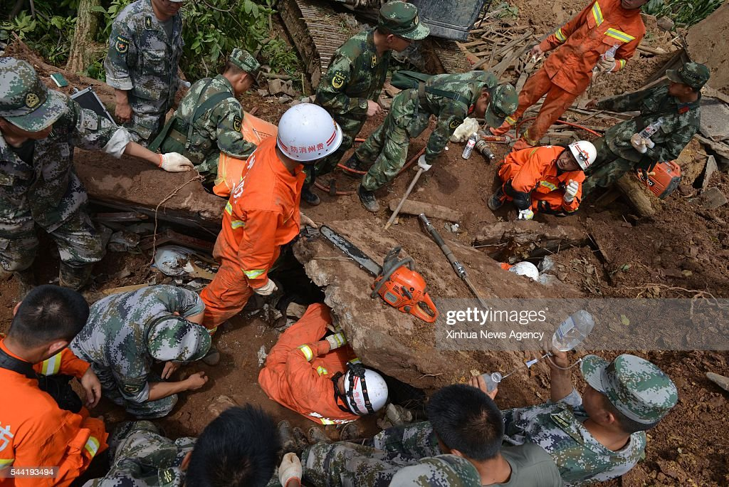 DAFANG, July 1, 2016 -- Rescuers work at the disaster site after a rain-triggered landslide hit Pianpo Village, Dafang County in the city of Bijie, southwest China's Guizhou Province, July 1, 2016. The landslide on Friday morning has caused 11 people dead and 12 missing.