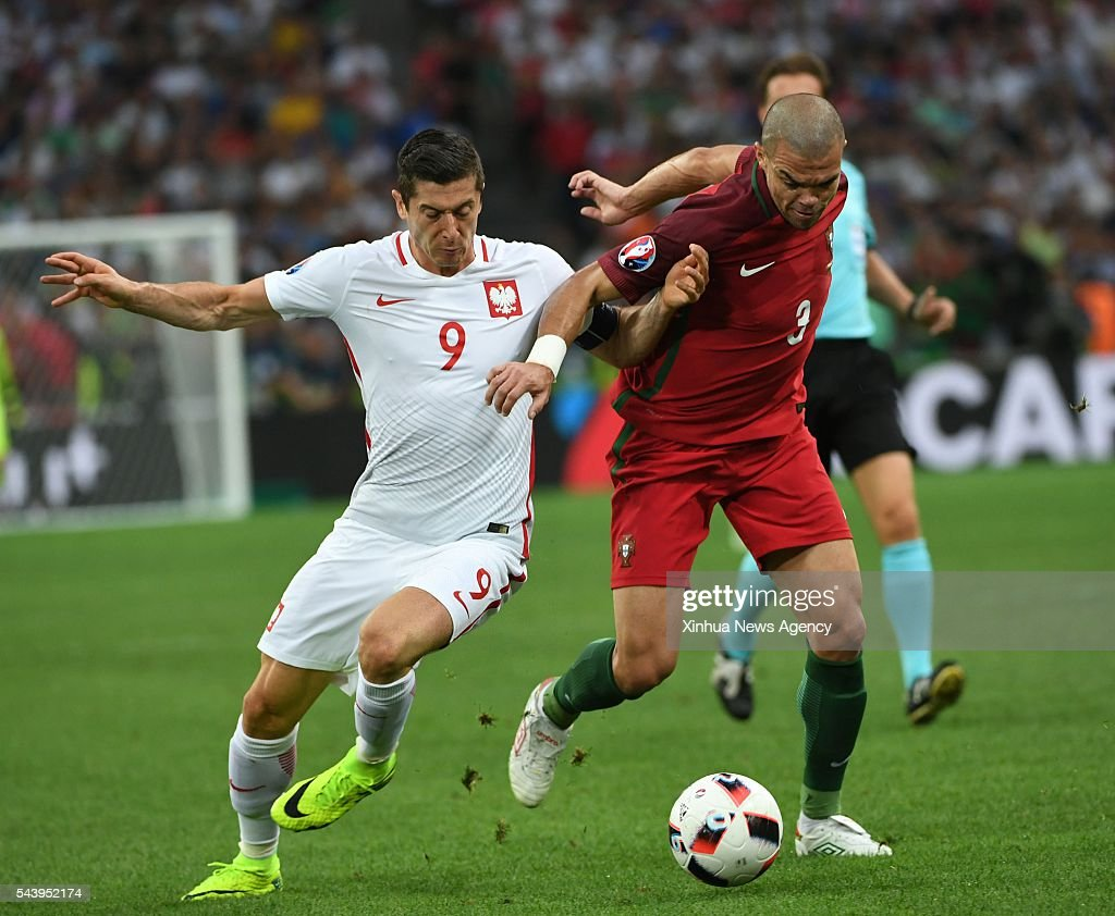 MARSEILLE, July 1, 2016 -- Robert Lewandowski of Poland, left, vies with Pepe of Portugal during the Euro 2016 quarterfinal match between Portugal and Poland in Marseille, France, June 30, 2016.