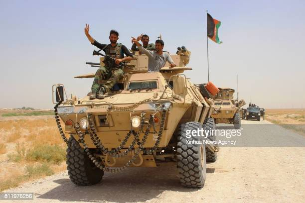 Afghan security force members take part in a military operation in Chimtal district of northern Balkh province Afghanistan July 9 2017 At least 69...