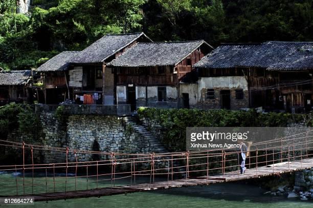 CHONGQING July 11 2017 Photo taken on Aug 1 2010 shows a view of Ningchang ancient town of Wuxi southwest China's Chongqing Municipality The history...