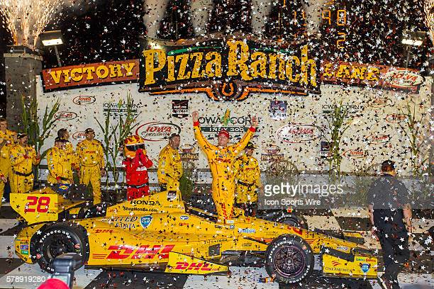 IndyCar Driver Ryan HunterReay celebrates in pizza each victory lane after winning the running of the Iowa Corn Indy 300 presented by DEKLAB at Iowa...