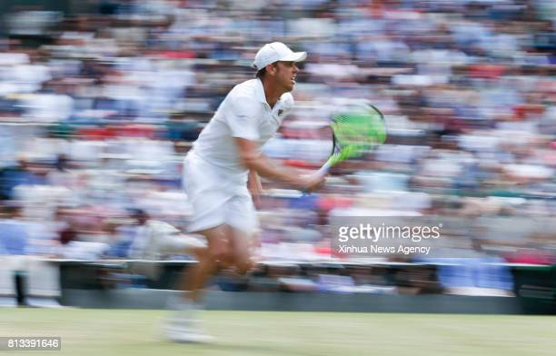 LONDON July 12 2017 Sam Querrey of the United States competes during the men's singles quarterfinals match with Andy Murray of Great Britain during...