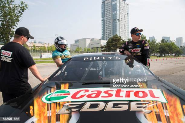 TORONTO ON July 12 2017 Sports reporter Mark Zwolinski takes a ride in a Castrol Dodge driven by St Thomas Ontario's DJ Kennington who competed in...
