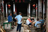 RUIJIN July 13 2016 Residents play cards in the Luo ancestral hall at Mixi Village of Jiubao Town in Ruijin City east China's Jiangxi Province July...