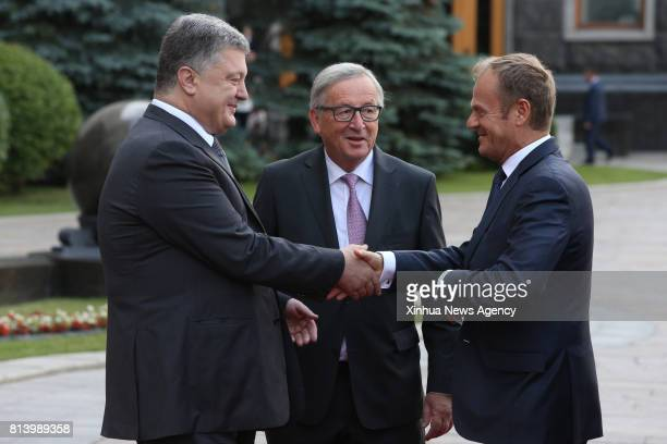 KIEV July 13 2017 Ukrainian President Petro Poroshenko shakes hands with European Council President Donald Tusk flanked by European Commission...