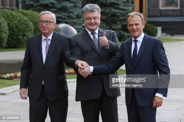 KIEV July 13 2017 Ukrainian President Petro Poroshenko welcomes European Council President Donald Tusk and European Commission President JeanClaude...