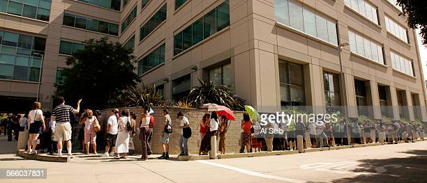 PASADENA CA – July 14 2008 – A IndyMac employee locks the door after entry of an employee while the first people in line took a seat at the door of...