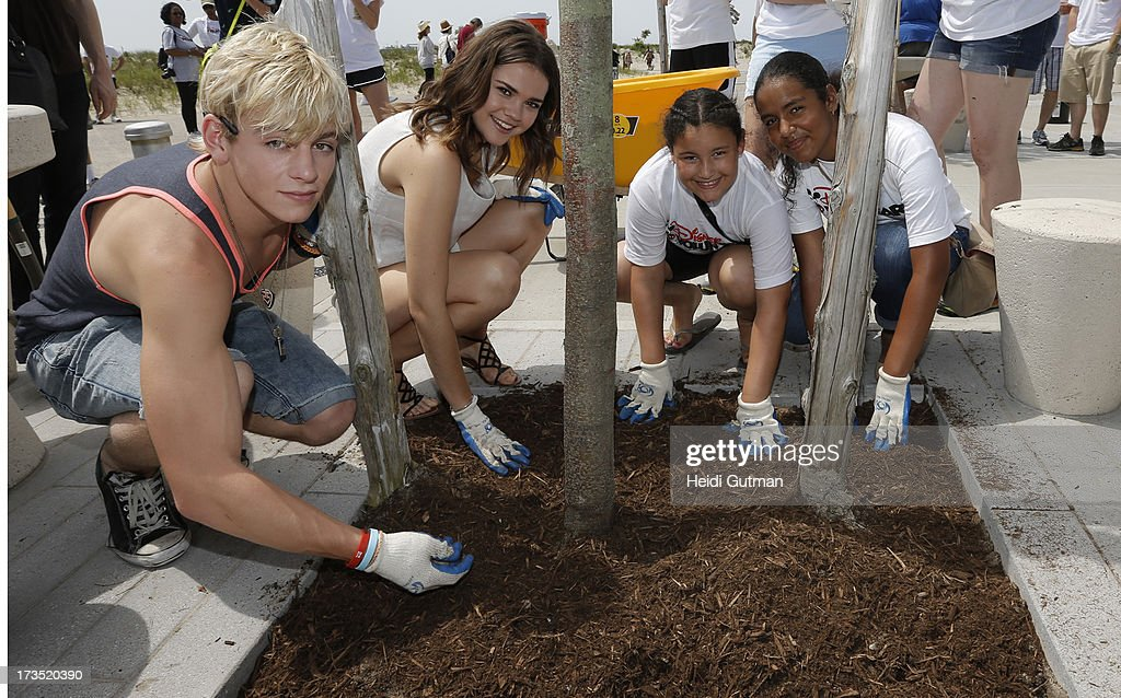 MOVIE - July 14, 2013 - Ross Lynch and Maia Mitchell, starring in the highly anticipated Disney Channel Original Movie, TEEN BEACH MOVIE, pitch in with volunteers from Verizon, Disney and NYC Partnership for Parks, to clean up Rockaway Beach in Queens, NY, that was devastated by Superstorm Sandy. (Photo by Heidi Gutman/Disney Channel via Getty Images) ROSS LYNCH, MAIA MITCHELL, VOLUNTEERS