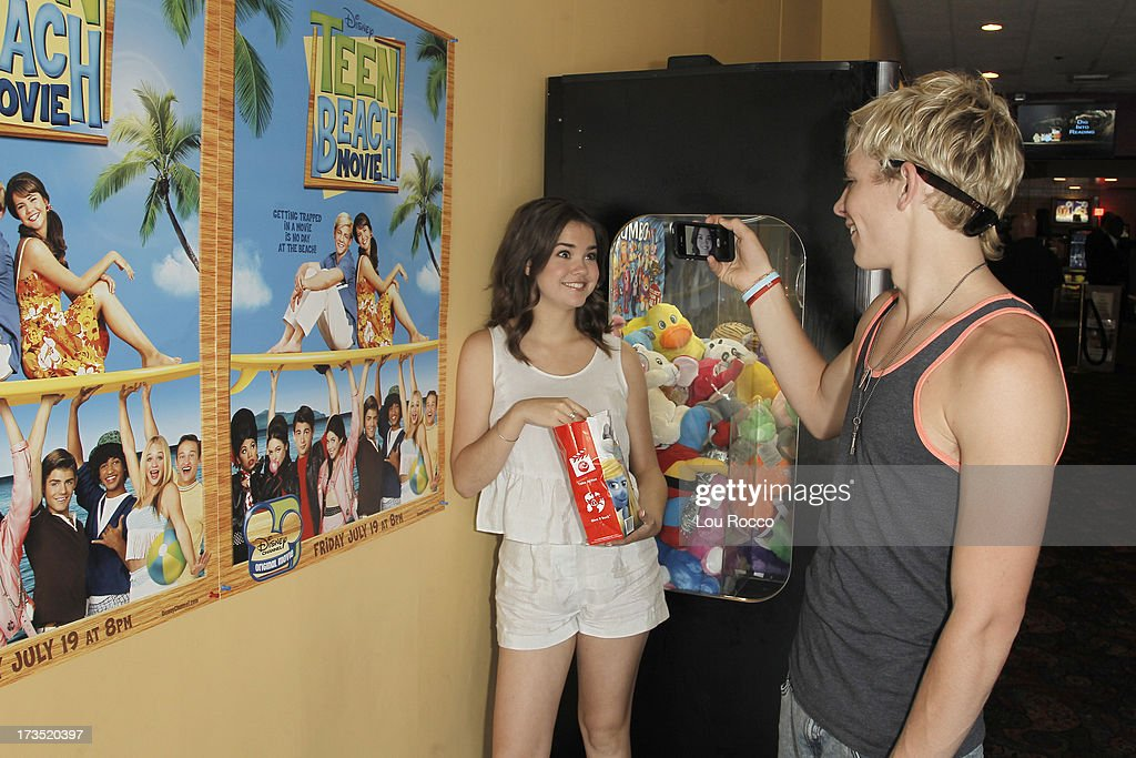 MOVIE - July 14, 2013 - Ross Lynch and Maia Mitchell, starring in the highly anticipated Disney Channel Original Movie, TEEN BEACH MOVIE, attend a screening of their film in Lincroft, NY, after they pitched in to clean up Rockaway Beach in Queens. (Photo by Lou Rocco/Disney Channel via Getty Images) MAIA MITCHELL, ROSS LYNCH