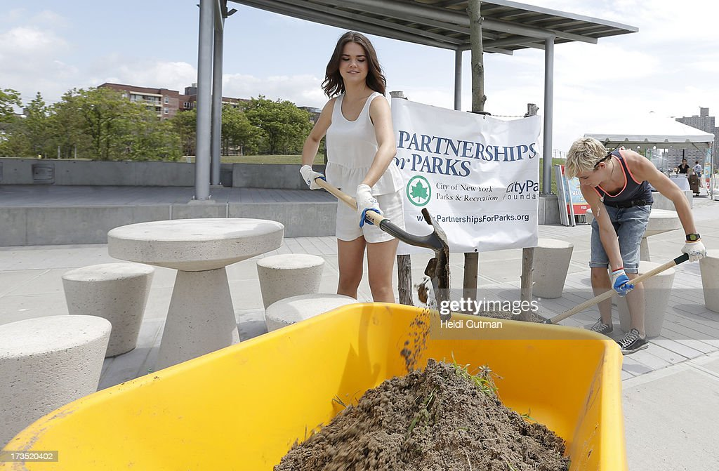 MOVIE - July 14, 2013 - Ross Lynch and Maia Mitchell, starring in the highly anticipated Disney Channel Original Movie, TEEN BEACH MOVIE, pitch in with volunteers from Verizon, Disney and NYC Partnership for Parks, to clean up Rockaway Beach in Queens, NY, that was devastated by Superstorm Sandy. (Photo by Heidi Gutman/Disney Channel via Getty Images) MAIA MITCHELL, ROSS LYNCH