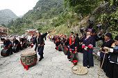 HECHI July 14 2015 Villagers of the Yao ethnic group dance to welcome guests during the Danu Festival in the Yao ethnic town of Sannong in Donglan...