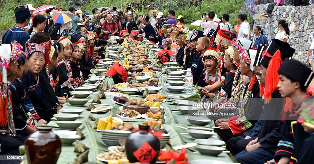 HECHI July 14 2015 Villagers of the Yao ethnic group enjoy a meal together during the Danu Festival in the Yao ethnic town of Sannong in Donglan...