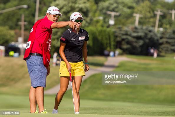 Hyo Joo Kim of South Korea discusses her put on the No 9 green with her caddie during the first round of the LPGA Marathon Classic presented by Owens...