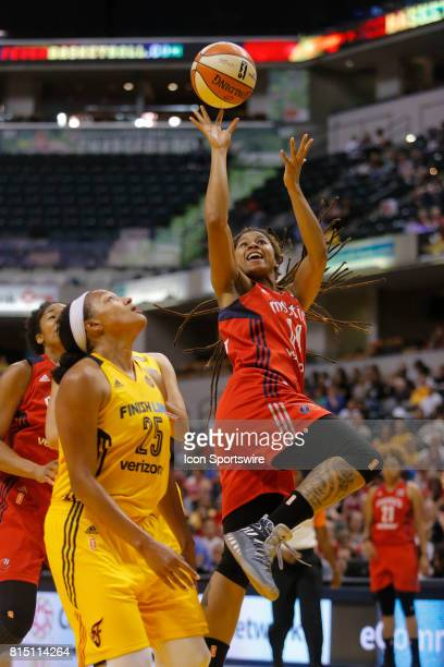 Washington Mystics guard Tierra RuffinPratt puts up her shot off the fast break over Indiana Fever forward Marissa Coleman during the game between...