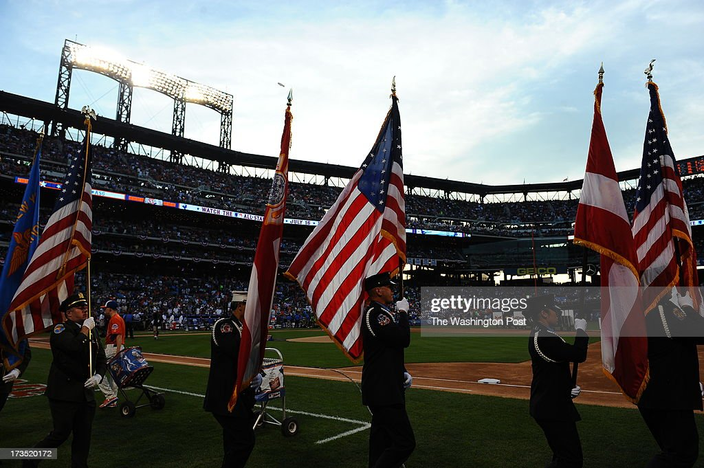 The Color guard leaves the field after the National anthem prior to the home run derby at the All-Star game on July 15, 2013 in New York, NY