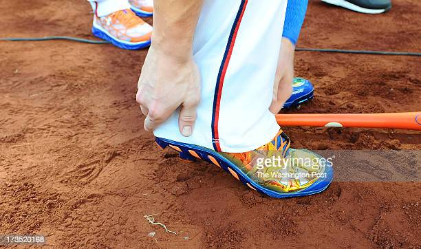 Washington Nationals Bryce Harper adjusts his pants leg over his shoes before he competes in the home run derby at the AllStar game on July 15 2013...
