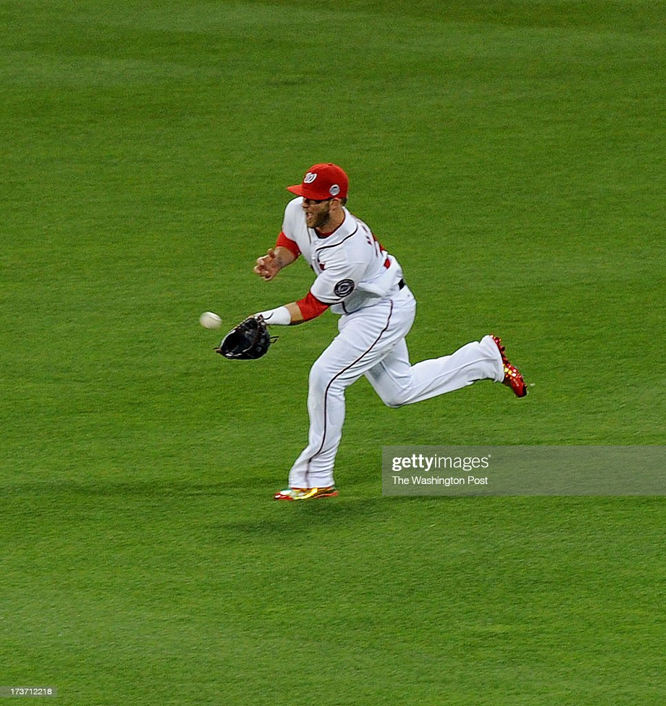 Washington Nationals Bryce Harper charges to make the catch on Baltimore Orioles Chris Davis during 1st inning action in the All-Star game on July 16, 2013 in New York, NY