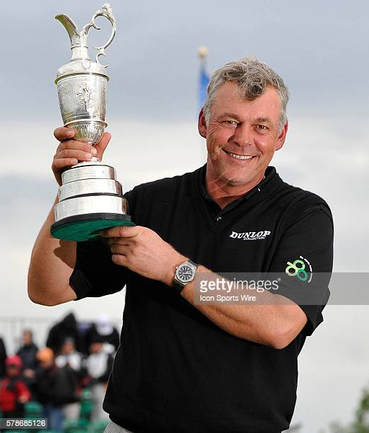 Darren Clarke holds up the Claret Jug after winning the Open Championship at Royal St Georges Sandwich Kent