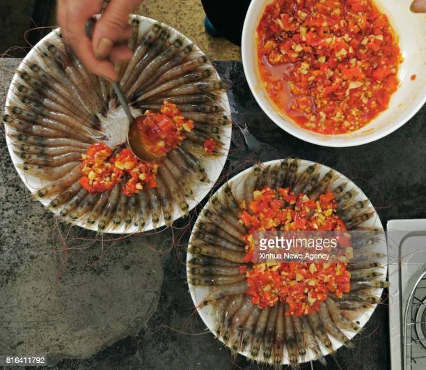 DEQING July 17 2017 Photo taken on July 14 2017 shows the specialty of shrimps at 'Jianqi Inn' in Deqing County east China's Zhejiang Province...