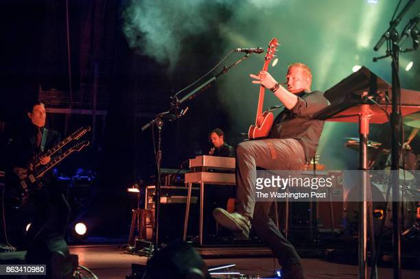 COLUMBIA MD July 17th 2014 Troy Van Leeuwen Dean Fertita and Josh Homme of Queens of the Stone Age perform at Merriweather Post Pavilion The band's...