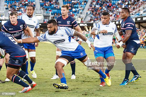 Manu Samoa Second Row Faatiga Lemalu grabs for USA Eagles Scrumhalf Shalom Suniula during the first half of the Pacific Nations Cup test match...