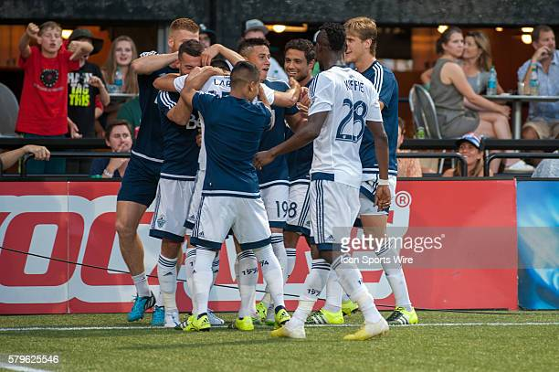 Matias Laba of Vancouver Whitecaps celebrates his goal with team mates and visiting fans Providence Park Portland OR