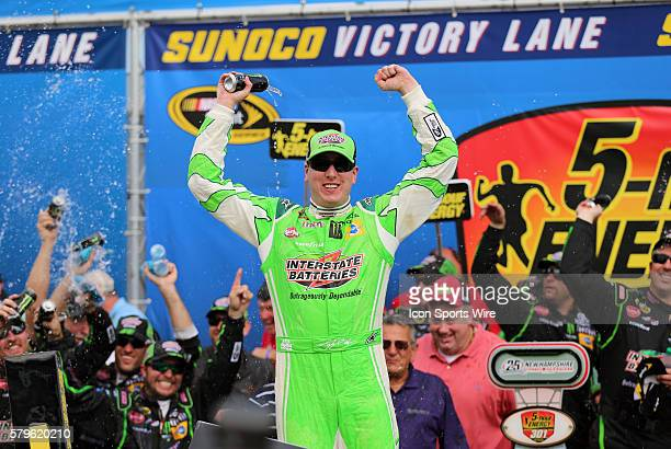 Kyle Busch Sprint Cup driver of the Interstate Batteries Toyota celebrates winning the 5hour ENERGY 301 at New Hampshire Motor Speedway in Loudon New...