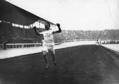 Wyndham Halswelle crosses the finish line to win one of the heats of the 400 Metres event at the 1908 London Olympics He went on to win the final...