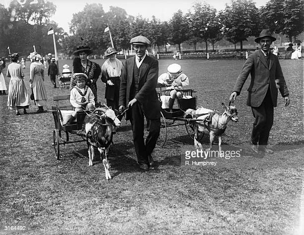 Children riding in goat carts at the Ranelagh Club children's day in Barnes south London