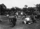 A crowd watching a boxing match at Bodmin in Cornwall
