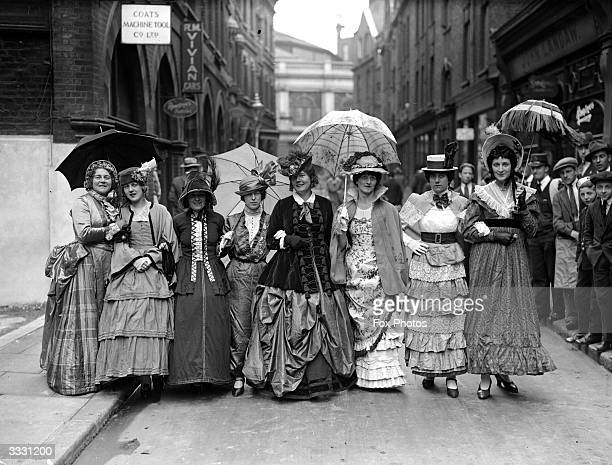 A group of women dressed in Victorian style clothing to celebrate the centenary of the London bus