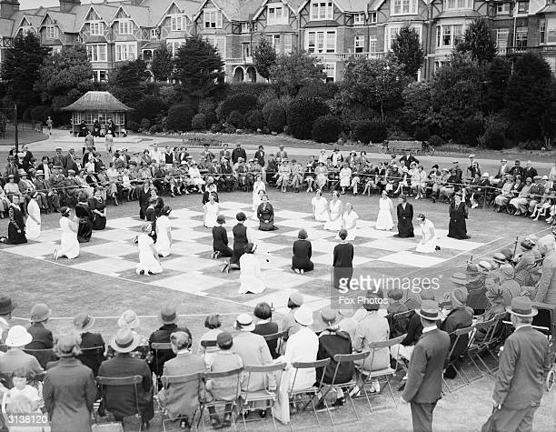 A game of draughts in Egerton Park using live people as pieces