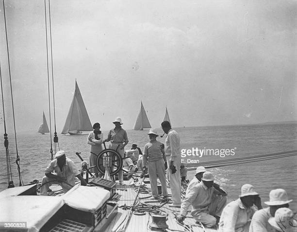 Endeavour Thomas Sopwith's America's Cup yacht in sail with its crew whilst other yachts sail in the background during the Cowes Regatta off the Isle...