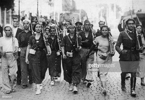 Male and female militia fighters on the march at the beginning of the Spanish Civil War