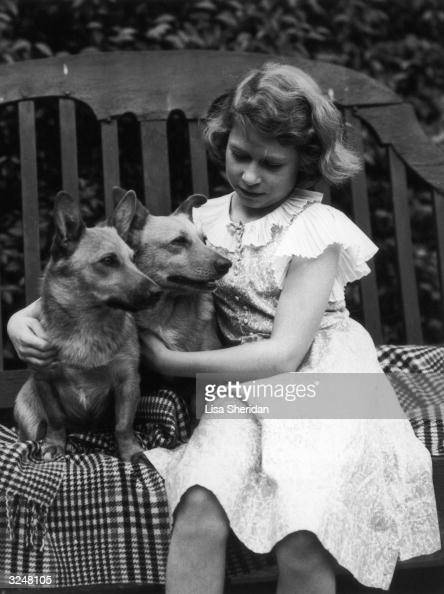 Princess Elizabeth in the grounds of her London home 145 Piccadilly with her pet corgis Jane and Dookie