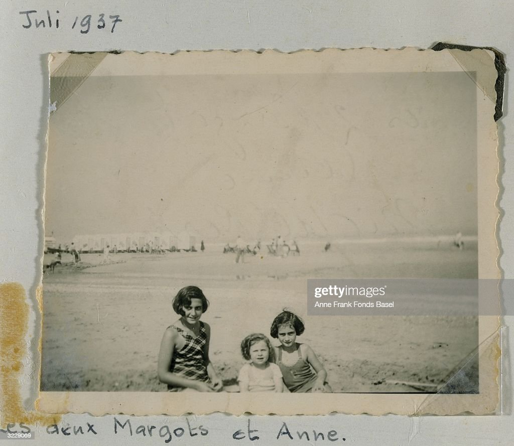 Portrait of Margot (left) and <a gi-track='captionPersonalityLinkClicked' href=/galleries/search?phrase=Anne+Frank&family=editorial&specificpeople=173492 ng-click='$event.stopPropagation()'>Anne Frank</a> (1929 - 1945), (right) on the beach with an unidentified younger girl taken from <a gi-track='captionPersonalityLinkClicked' href=/galleries/search?phrase=Anne+Frank&family=editorial&specificpeople=173492 ng-click='$event.stopPropagation()'>Anne Frank</a>'s photo album, Middelkerke, Belgium.