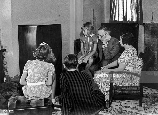 A family spend quality time at home together listening to the wireless