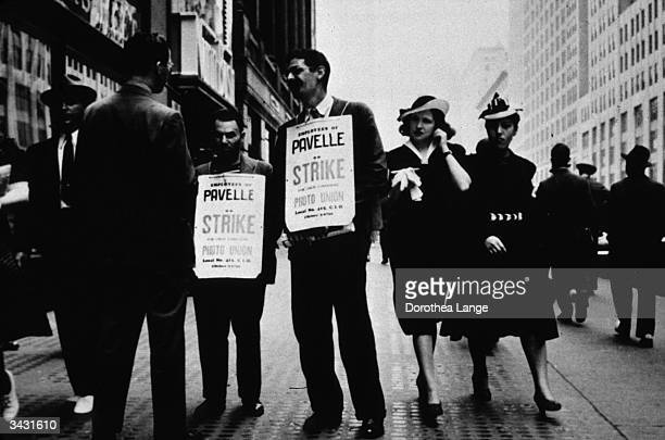 Members of a Photo Union on a picket line on 42nd Street New York City