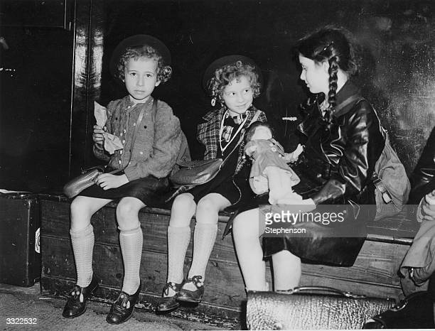 Three Jewish refugee children from Germany and Austria the 'Kindertransport' waiting to be collected by their relatives or sponsors at Liverpool...