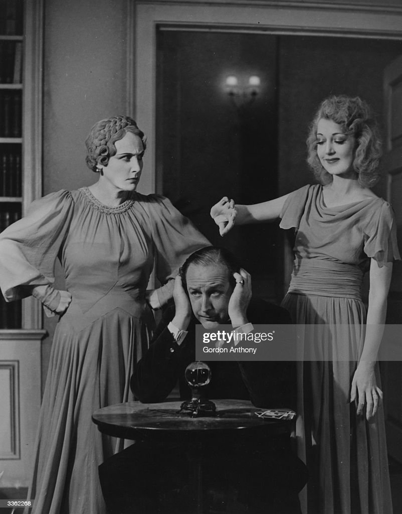 Fay Compton (1894 - 1978) as Ruth, Cecil Parker (1897 - 1971) as Charles and Kay Hammond (1909 - 1980) as Elvira in the Noel Coward play 'Blithe Spirit' at the Piccadilly Theatre, London.