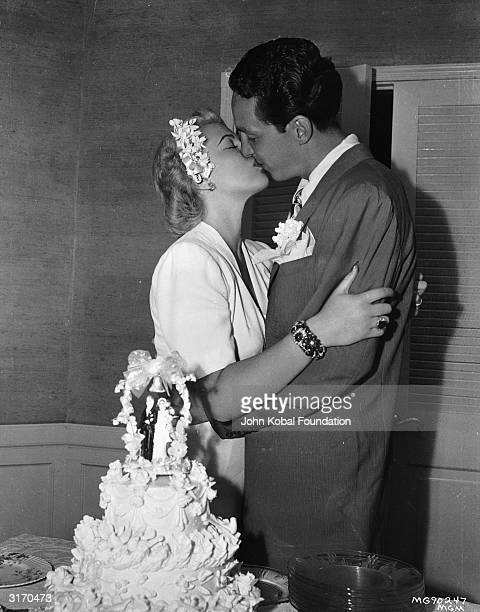 Hollywood actress Lana Turner kisses her second husband Steve Crane on their first wedding day Turner was to marry a total of eight times twice to...