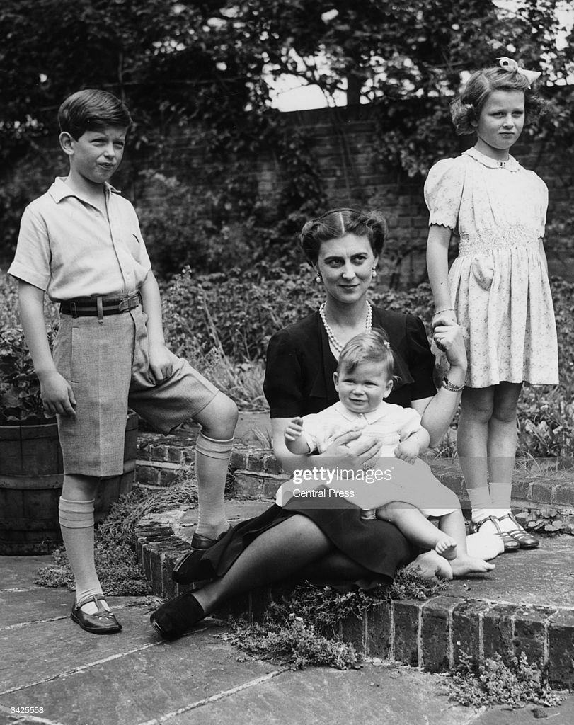 Marina, Duchess of Kent with her three children, Prince Edward (later Duke of Kent), Princess Alexandra and Prince Michael on his first birthday, at Coppin's Ivor, Buckinghamshire.