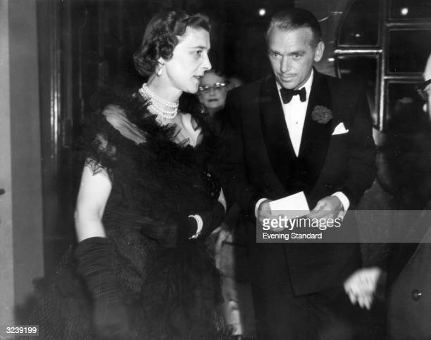 American actor Douglas Fairbanks Jr at the Coliseum Theatre with the Duchess of Kent to see 'Mr Roberts'