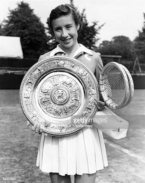 American tennis player Maureen Connolly with the women's singles trophy after beating Doris Hart in the final at the Wimbledon Lawn Tennis...