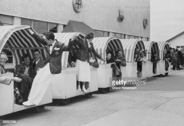 Entertainers at Butlin's Holiday Camp Skegness performing to passengers touring the camp on a transport trailer Original Publication Picture Post...